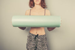 Athletic young woman with foam roller Stock Images