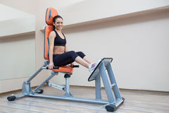 Athletic young woman in gym Stock Images