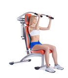 Athletic young woman on isodynamic exerciser Stock Image