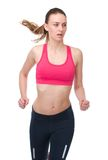 Athletic young woman jogging Stock Photography