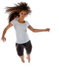 Athletic young woman leaping towards the camera Stock Photo