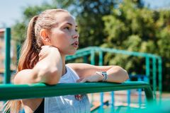 Athletic young woman looks into distance on sports field. Portrait. Athletic young woman looks into the distance on the sports field. Portrait stock photo
