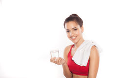 Athletic woman with glass of water Stock Photography
