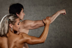 Athletic young woman and man Royalty Free Stock Image