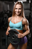 Athletic young woman model posing and exercising fitness workout Stock Photography