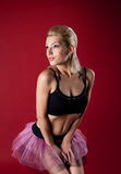 Athletic young woman posing in dance rose costume Stock Photos