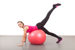 Athletic young woman with red bal Stock Images
