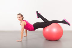 Athletic young woman with red ball Stock Photo