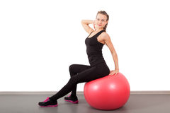 Athletic young woman with red ball Stock Photography