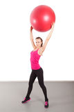 Athletic young woman with red ball Royalty Free Stock Photos