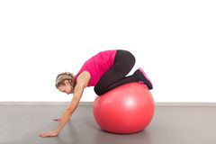 Athletic young woman with red ball Stock Image
