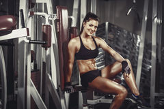 Athletic young woman resting after exercise in the gym royalty free stock photos