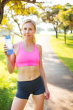 Athletic young woman runner drinking water Stock Photo