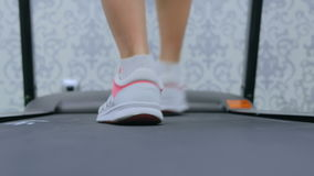 Athletic young woman running on treadmill at the gym. Fitness club. Close up shot of woman`s legs. Health, sport and cardio workout concept stock footage