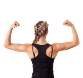 Athletic young woman showing biceps. Isolated on white royalty free stock photo