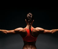 Athletic young woman showing muscles of the back Stock Photography