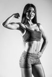 Athletic young woman showing muscles of  hands. Stock Image