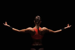 Athletic Young Woman Showing Muscles Of The Back Royalty Free Stock Images