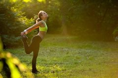 Athletic young woman in sports dress doing fitness stretch Royalty Free Stock Photography