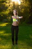 Athletic young woman in sports dress doing fitness stretch Royalty Free Stock Photo