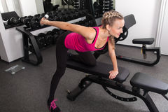 Athletic young woman training with dumbbell Royalty Free Stock Images