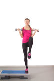 Athletic young woman training with dumbbell Royalty Free Stock Photos