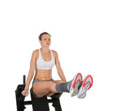 Athletic young woman training on exerciser Royalty Free Stock Photo