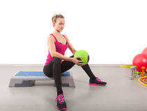 Athletic young woman training with green ball Royalty Free Stock Images