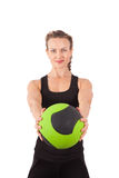 Athletic young woman training with green ball Royalty Free Stock Photos