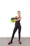 Athletic young woman training with green ball Royalty Free Stock Photo