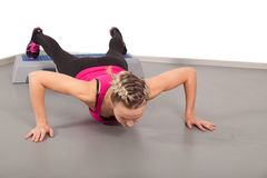 Athletic young woman training in the gym Royalty Free Stock Images