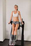 Athletic young woman training press on exerciser Royalty Free Stock Image