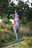 Athletic young woman working out in the country Stock Images
