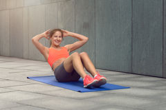 Athletic young woman working out Stock Images