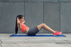 Athletic young woman working out Stock Image