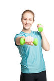 Athletic young woman works out with green dumbbells Royalty Free Stock Image