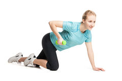 Athletic young woman works out with green dumbbells Royalty Free Stock Photos