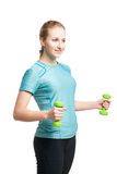 Athletic young woman works out with green dumbbells Stock Image
