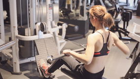 Athletic young woman works out on training apparatus. Athletic young woman works out on training appliance stock video