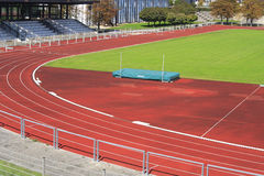Athletics. Red athletics track with green field Stock Images
