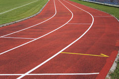 Athletics. Red race track with white lines, athletics Royalty Free Stock Photos