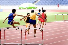 Athletics. Malaysian School Athletic Meet. Image shows participants of the Boys Under 15 years old 400 Meters Hurdles race Royalty Free Stock Photo