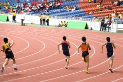 Athletics. Malaysian School Athletic Meet. Image shows participants of the Boys Under 15 years old 200 Meters race Stock Images