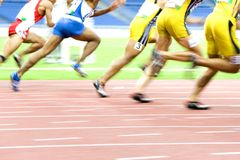 Athletics. Image of 100 meters athletes in action with intentional blurring Stock Images