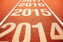 2015 on athletics all weather running track. Number 2015 on athletics all weather running track withe preceeding and following years. Happy new 2015 year Stock Image