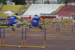 Athletics discipline - 100 metres hurdles. Male competitors performing during the  100 metres hurdles discipline at Romanian International Atheltics Championship Royalty Free Stock Photography