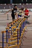 Athletics discipline - 100 metres hurdles. Male competitors performing during the  100 metres hurdles discipline at Romanian International Atheltics Championship Royalty Free Stock Images