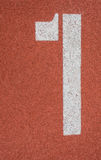 Athletics field and number. Athletics Track Lane made with orange rubber Royalty Free Stock Images