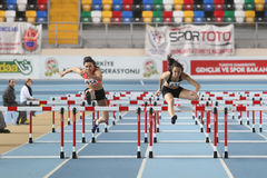 Athletics. ISTANBUL, TURKEY - FEBRUARY 01, 2015: Athletes run steeplechase during Turkish Athletic Federation Olympic Threshold Indoor Competitions in Asli Cakir royalty free stock photography