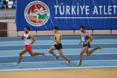 Athletics. ISTANBUL, TURKEY - JANUARY 24, 2015: Athletes run during Turkish Athletic Federation Indoor Athletics Competition in Asli Cakir Alptekin Athletics royalty free stock photos
